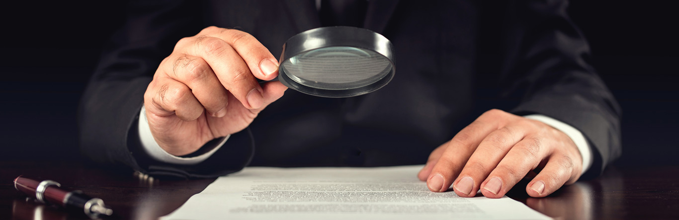 Title Examiner with magnifying glass