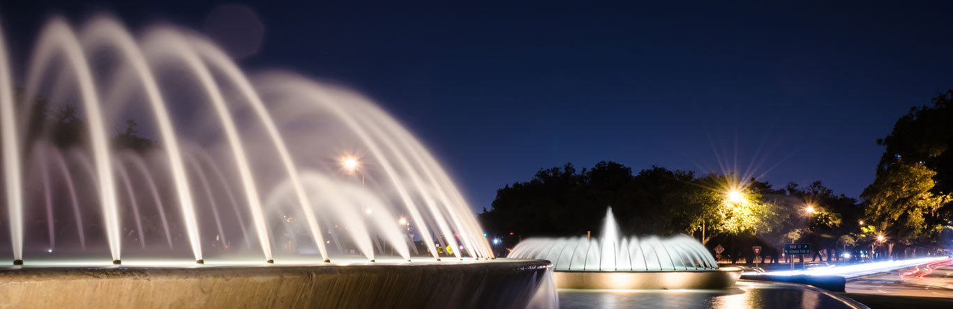 fountains in pond at night time